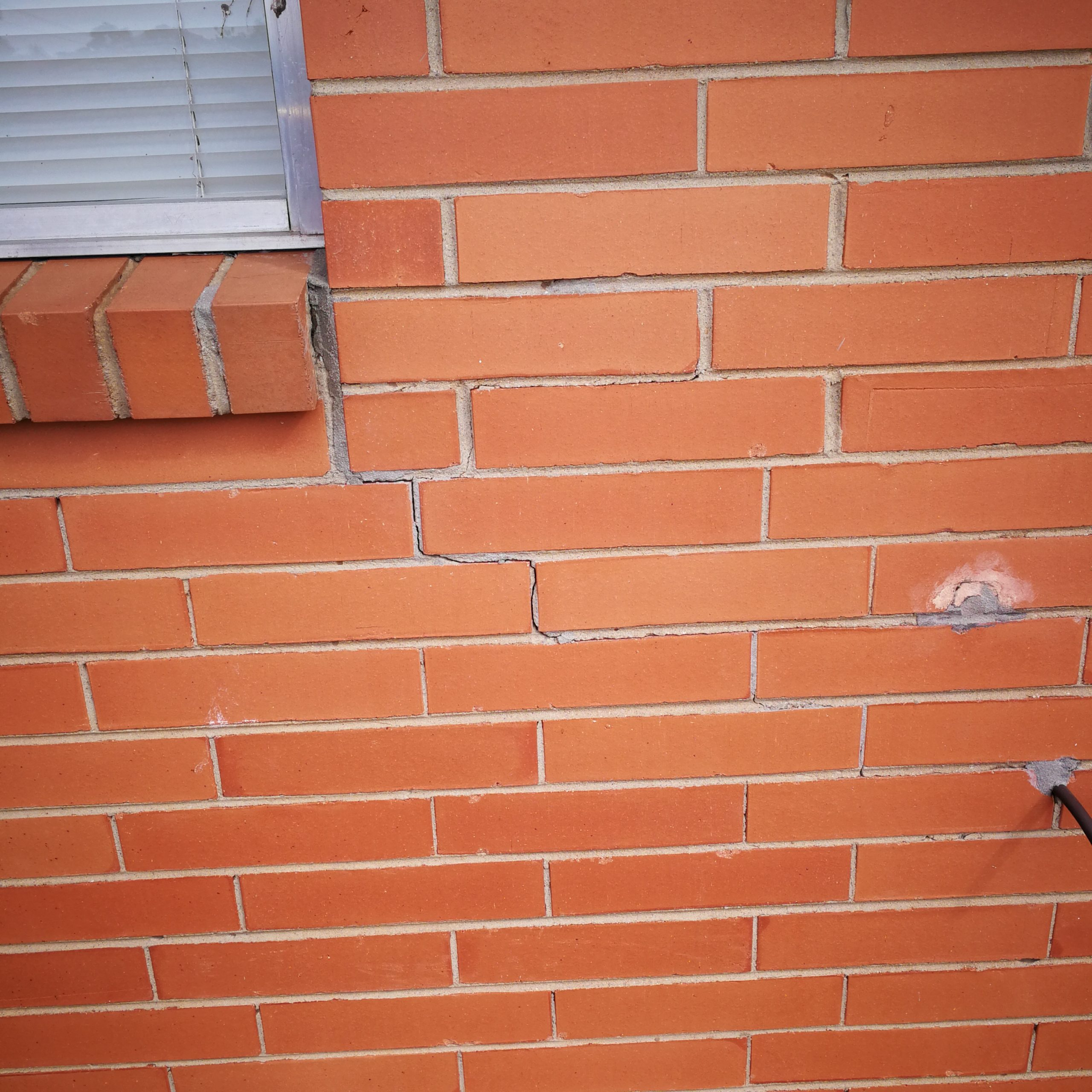 why do walls crack
